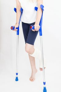 Young girl with broken leg on crutches